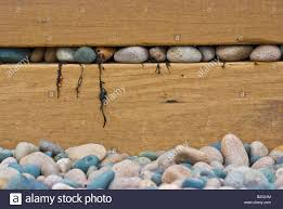 a modern art image featuring smooth pebbles and stones wedged into