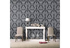 diese tapete besticht durch die grau schwarzen ornamente