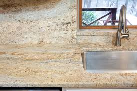kashmir gold granite in an log cabin in owings md traditional