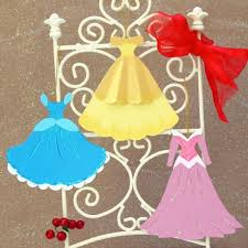 glitter glue and paper doily ruffles these paper gowns — modeled after the ones worn by Cinderella Aurora and Belle — are designed to dress up a tree