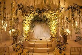 Indoor Garden Ceremony With White Roses And Orchids Greenery