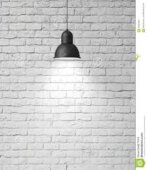 hanging white l with shadow on vintage white painted brick wall