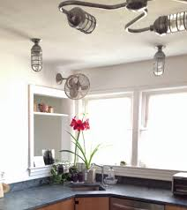 industrial lighting gives 1950s kitchen new vibe