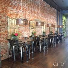 Brick Wall With Reclaimed Wood Accent Panels Tables Made From Pipe Tolix Metal Bar Rustic RestaurantRestaurant