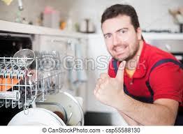 Worker Repairing The Dishwasher In Kitchen Main Focus On Hand