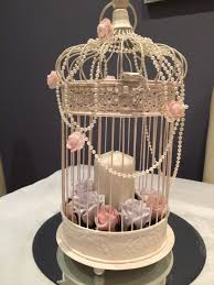 Shabby Chic Wedding Decorations Hire by Pale Pink And Grey Roses Candles And Pearls In A Shabby Chic Bird