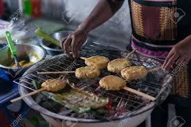 Sticky Rice Grilled On Stove Tasty Snack North East Thai Cold Weather Stock Photo