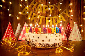 happy birthday cake with candles on the background of garlands a