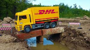 BRUDER Truck DHL Falls Into Water - YouTube Bruder Toys Man Tipping Truck W Schaeff Mini Excavator 02746 Youtube Bruder Truck Dhl Falls Into Water Trucks For Children Scania Timber Pimp My My Amazing Toys Cement Mixer Model Toy Truck Which Is German Sale Trucks Side Loading Garbage Review 02762 Hecklader Mll Lkw Operated By Jack3 Bruder Dodge Ram 2500heavy Duty2017 Mb Sprinter Animal Transporter 02533 Tractor Case Plowing With Lemken Plow Kids Video World Cat Excavator Riding In The Mud Videos Children Chilrden Matruck Played Jack 3