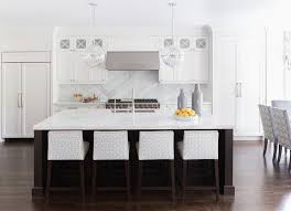 white kitchen with brown island illuminated by cyan design janus