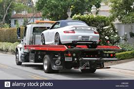 A Tow Truck Tows Victoria Beckham's Signature Porsche From Her Home ... Cheap Towing Los Angeles Airtalk In An Accident Beware Of Tow Truck Scammers 893 Kpcc In 247 The Closest Tow Truck Service Nearby Types Equipment Green File1932 Ford Model Bb Truckjpg Wikimedia Commons Platinum Ventura Countys Premier Recovery Southland Best And Gallery Industries Ca Trucks United Carrier Services Auto Transport 90015 Cole Keattss Car During Red Bull Global R 2008 Gmc Topkick C5500 5003716866