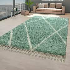 hochflor teppich grün wohnzimmer skandinavisches rauten