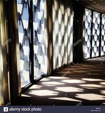 a dramatically lit hallway with patterns in a mid century modern