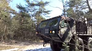 Oshkosh Truck Laden With Humvee Jeep Being Driven Though Woodland ... Okosh A98 3200g969 Stock Fda237 Front Drive Steer Axle Tpi Military Roller Chock Truck 1450130u Hemtt Ebay 3 Top Stocks Youve Been Overlooking The Motley Fool Model M911 Winsdhield Parts Kit 3sk546 251001358 Terramax Flatbed 2013 3d Model Hum3d Kosh For Sale N Trailer Magazine Cporation Wikipedia Trucks Photos Todays 5 Picks Unilever More Barrons