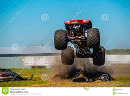 100 Truck Jumping Red Monster Truck Stock Image Image Of Under High Dirt 86409105