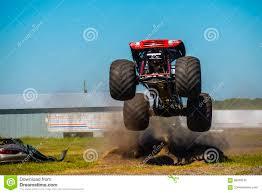 100 Red Monster Truck Monster Truck Stock Image Image Of Under High Dirt 86409105