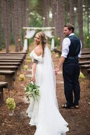 Woodsy Woodland Wedding Ceremony Reception Wisconsin Bride Groom Mr Mrs Outdoor Pines Pine Tree Arbor Arch