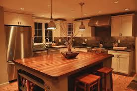 rich wooden kitchen island with white kitchen cabinet and