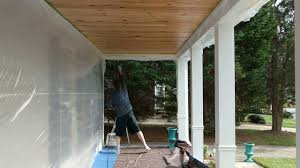 Using A Paint Sprayer For Ceilings by Spraying Pine Porch Ceiling Using Harbor Freight Airless Paint