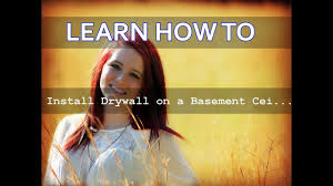 Installing Drywall On Ceiling In Basement by How To Install Drywall On A Basement Ceiling Youtube