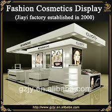 High Grand Makeup Kiosk Design With Glass Showcase And Cosmetics Rack Display Stand For Mall Or