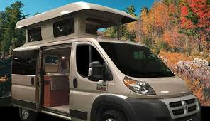 Custom Beige ProMaster Camper Van Conversion With The Exanded Penthouse Top And Open Sliding Door