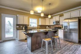 kitchen with simple granite counters raised panel in wyoming mi