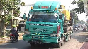 100 Nissan Diesel Truck UD Self Loader Transporting Komatsu PC200