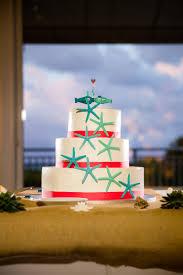 Elegant White Wedding Cake With Chocolate Starfish And Fish Topper