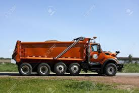 100 Dump Trucks Videos Orange Truck Loaded Going Down A Highway Stock Photo Picture