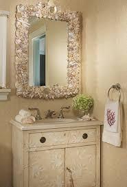 beach inspired bathroom with decorative wall mirror with sea sheel
