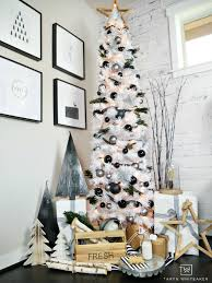 Taryn Creates This Modern Black And White Christmas Tree Display In Her Home Using A Tall Skinny With Silver Ornaments Wood
