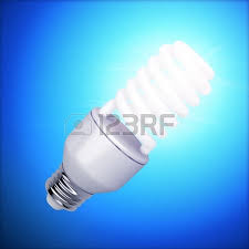 bright fluorescent light bulb on blue background stock photo