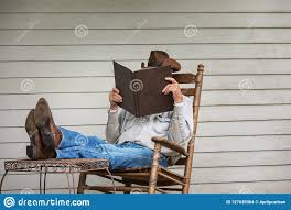 Cowboy Relaxing On Porch In Rocking Chair Stock Photo ...
