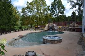 Hybrid Pool {MIN} In Ortonville, MI – Legendary Escapes Stunning Cave Pool Grotto Design Ideas Youtube Backyard Designs With Slides Drhouse My New Waterfall And Grotto Getting Grounded Charlotte Waterfalls Water Grottos In Nc About Pools Swimming Latest Modern House That Best 20 On Pinterest Showroom Katy Builder Houston Lagoon By Lucas Lagoons Style Custom With Natural Stone Polynesian Photo Gallery Oasis Faux Rock 40 Slide