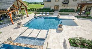 tuscany beige pool copings are crafted from travertine and