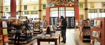 Two people browse the book aisles of Rowan Barnes & Noble