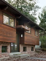 Engineered Wood Siding Lowes With Contemporary Exterior And Brick Canopy Concrete Walkway Curb Appeal Dark Brown Glass Front Door Trim