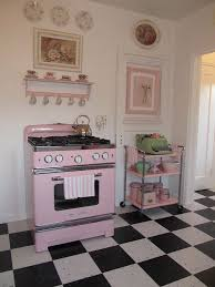 Retro pink stove and vintage pink cart