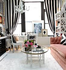 Exquisite Eclectic Livingroom Light Wood Floors Decoratively Round White Dining Table With Curtains Black And Open Shelving Unit