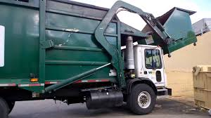 Garbage Truck Emptying A Dumpster - YouTube