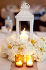 Lantern Centerpiece With Hydrangea And Candle Accents