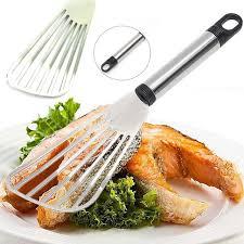pelle cuisine acier inoxydable plat tranche de poisson friture spatule qui fuit