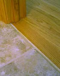 Wood To Tile Metal Transition Strips by Installing Hardwood Against Tile Transition Without Moldings