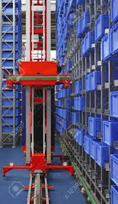 Automated Storage Warehouse With Blue Plastic Crates Stock Photo