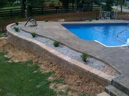 inground pool with retaining wall