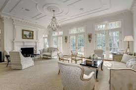 Luxury Living Room With Hampton Design Fireplace Chandelier And Louis Xvi Armchairs