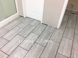 how to tile a bathroom floor with 12x24 gray tiles hometalk
