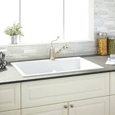 white porcelain kitchen sink cleaning lowes enamel small cast iron