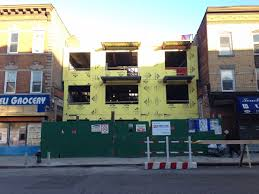 Bed Stuy Fly by Six Story 10 Unit Building Sprouts On Single Story Store On Bed